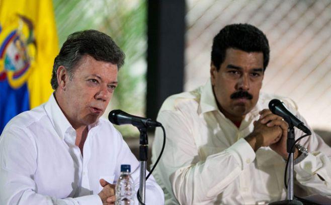 Presidente colombiano, Juan Manuel Santos, junto al mandatario venezolano, Nicolás Maduro. . Efe